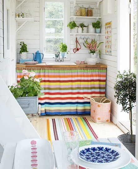 minimal open shelving with curtained under counter storage + the cheerful colors