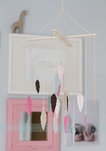 DIY idea: fabric, paint stick, and cloth feather mobile.