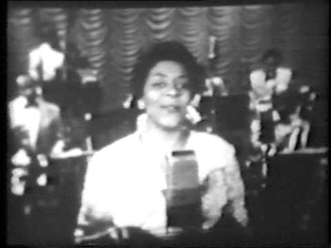 "When I first heard Dinah Washington, I asked ""Who is she? Where has she been all my life""?  That betrays my ignorance more than anything else.       Here Dinah Washington sings what is her best known song 'What A Difference A Day Made' and 'Making Whopee' with the Louis Jordan Band. Louis and our prez Ronald Reagan (!) make the announcements.    One of few videos I could find of Dinah Washington performing."