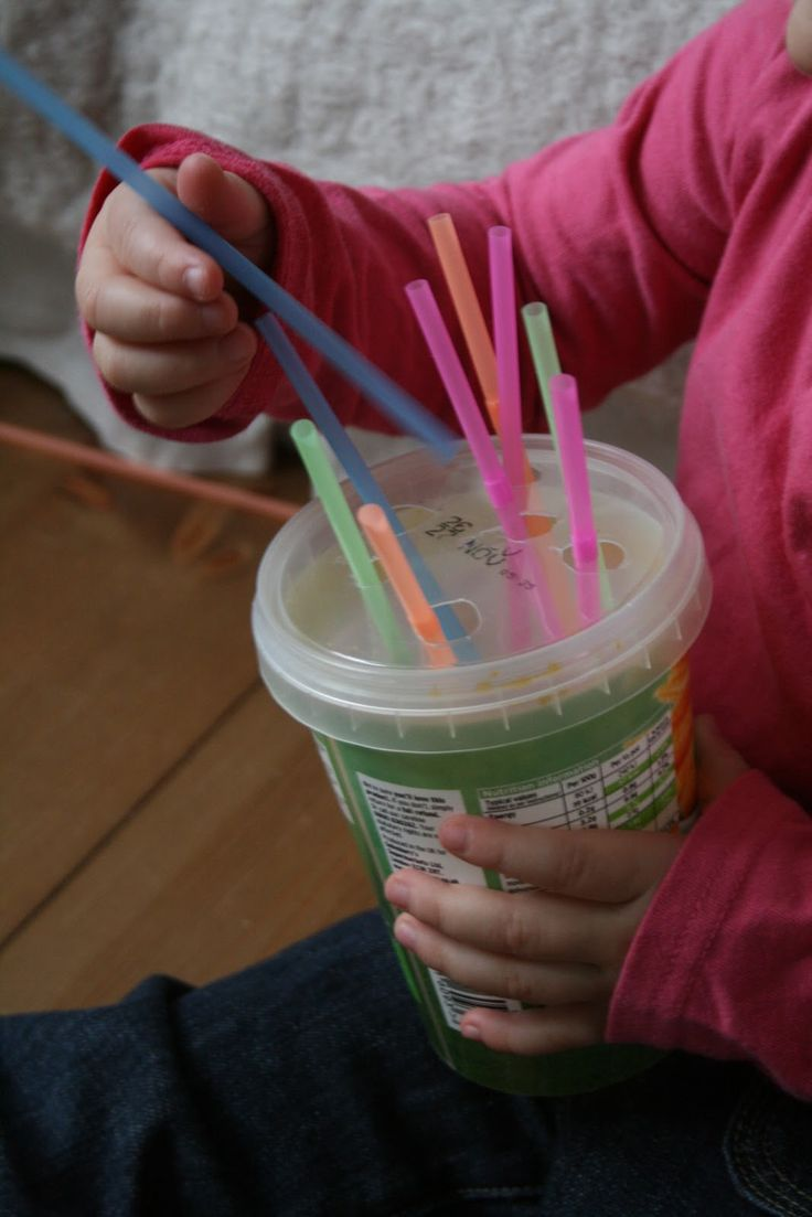 Toddler Discovery Box: poking straws into holes