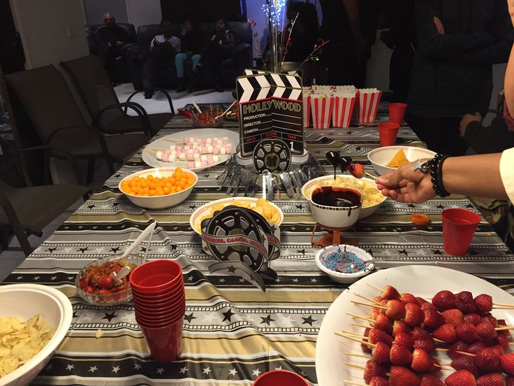 Hollywood themed birthday setup. With chocolate dipped strawberry, popcorn, chips and more