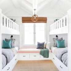 Coastal White Kids' Room With Four White Bunk Beds