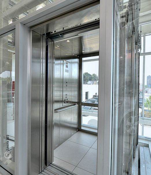 Savaria orion commercial elevator stainless steel cab - Commercial steel exterior doors with glass ...