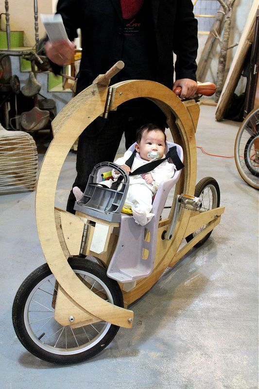 This very clever wood bike also features a protected baby seat.