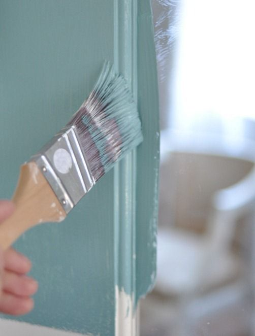 Painting french doors - she chose a medium shade of teal blue by Glidden called 'Still Waters'.  Love this color.