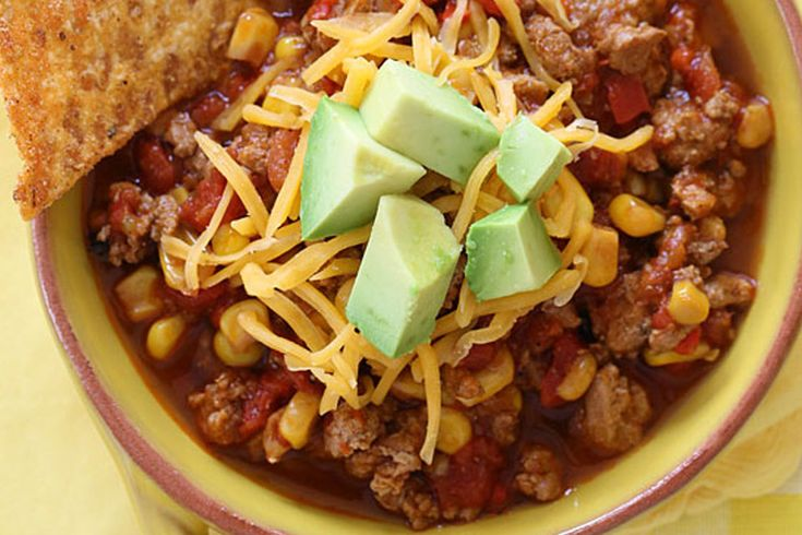 This mild kid-friendly crockpot chili, courtesy of Skinnytaste, is made with lean ground turkey, corn, bell pepper, tomatoes and spices. Top with with crunch baked tortilla chips and watch your lit...