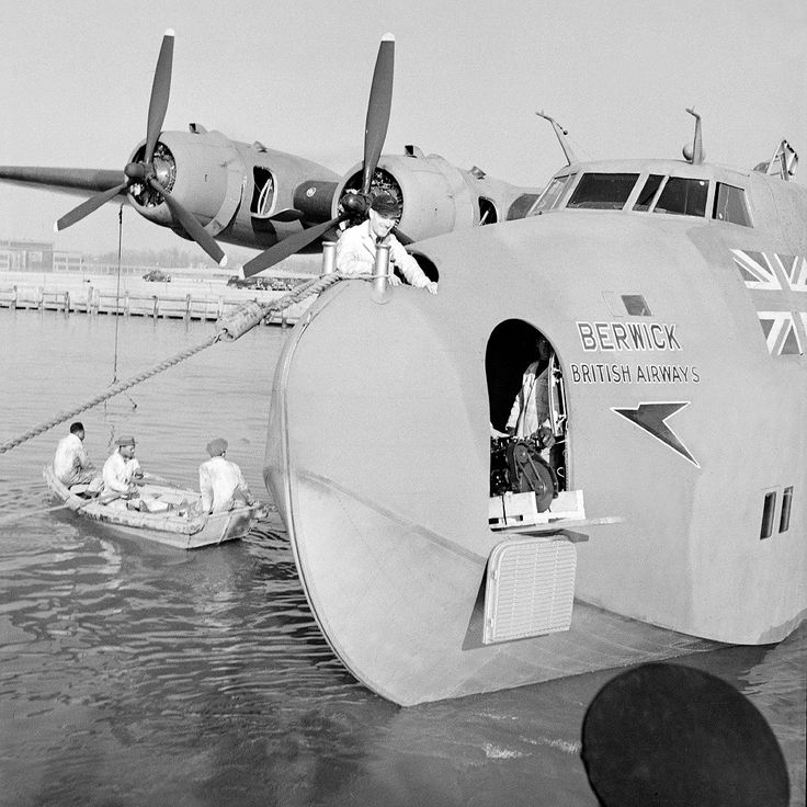 G-AGCA. British Airways - in the wartime livery at Port Washington Marine Terminal, La Guardia, August 1945.  © Whites Aviation / Alexander Turnbull Library Image WA-00472-F via P. Sheehan Collection - 1950-097.