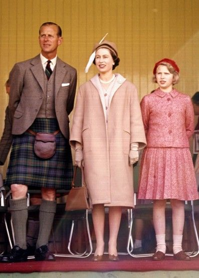 It's 1962, and the Queen embraces Sixties style in a sugary pink cashmere coat and hat complete with statement feather detail to attend the Highland Games.