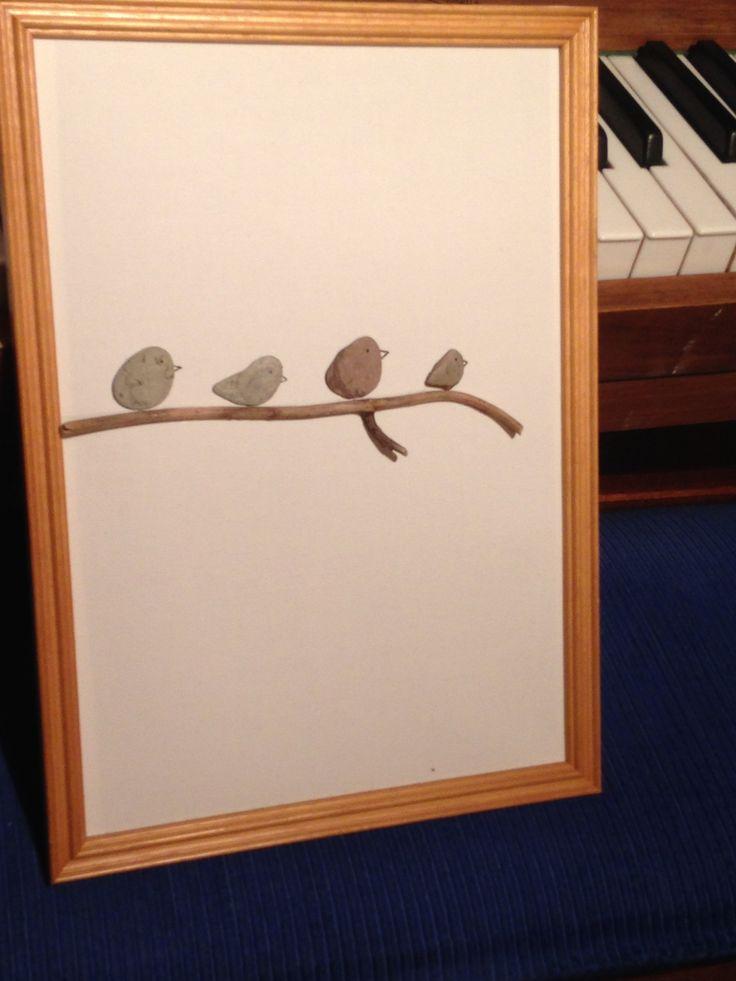 Four little birds, pebbles, twig