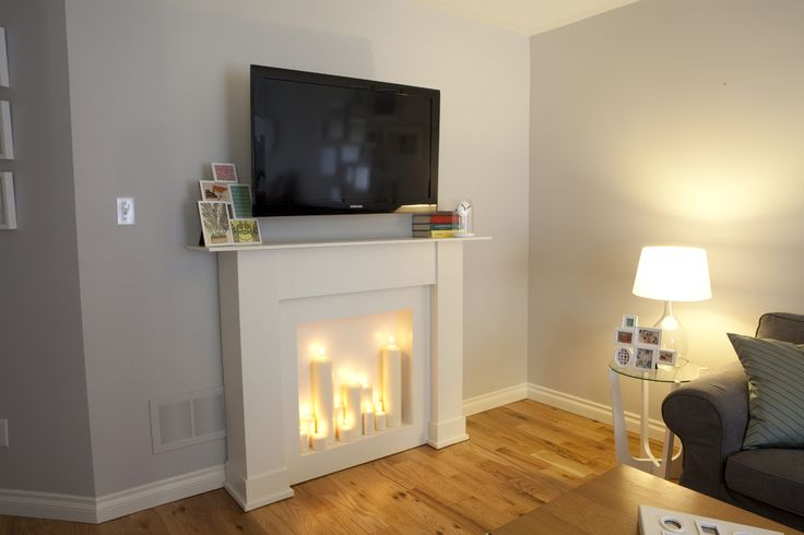 """A sweet simple mantel, with a """"fake"""" fireplace. I would love to do this, and use more mill work on it. Imagine the storage you could have with a mantel like this, plus a wonderful display stand too."""