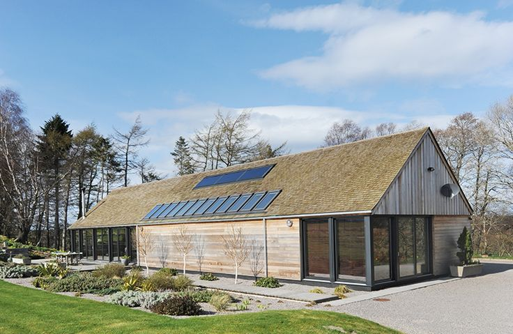 Glazing at both sides of the house allow pleny of light in, as do the Velux rooflights