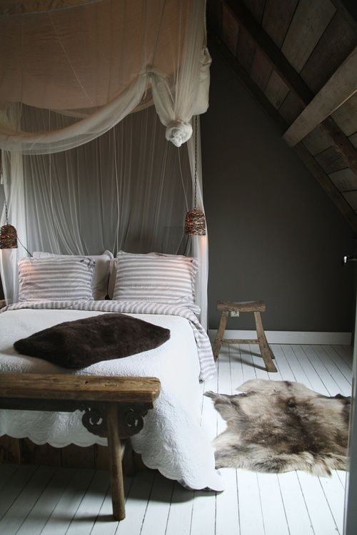 perfect mix of colour palette then animal rug and romantic net over bed - clean yet soft and cosy