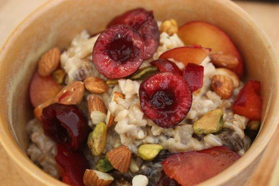 Whole Oat Groats with Cherries, Plums, Pistachios & Homemade Almond Milk recipe on Food52.com
