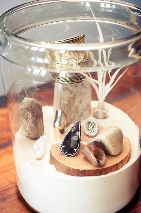 Love the idea of white sand in a beautiful jar with items for children to explore.