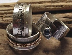 Two sterling silver spinner rings and one wrap ring with kyanite stone by Jill Endicott Jewellery.