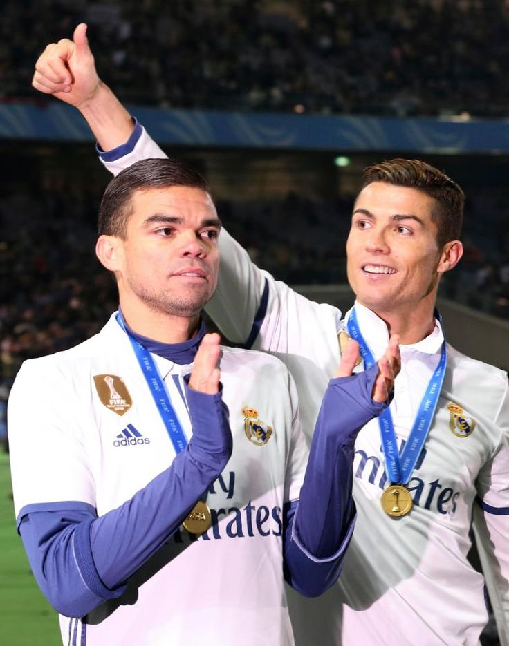 Pepe celebrates winning the FIFA Club World Cup with Cristiano Ronaldo