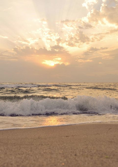 One of the most beautiful places on Earth....ocean waves, white foam on the beach and breaking dawn.