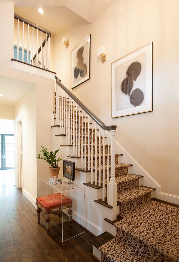 leopard stair runner and  Lucite entry table