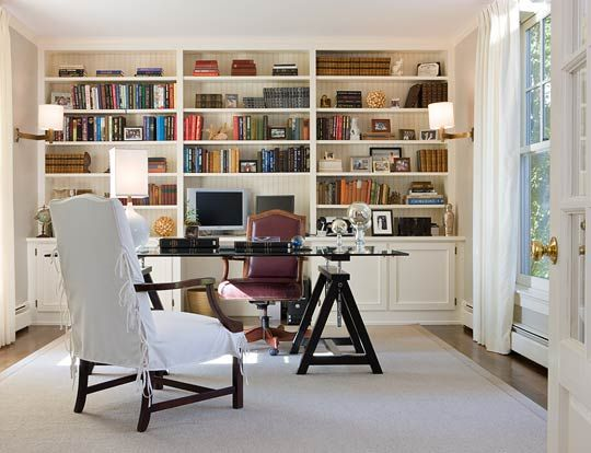 Sophisticated Office Spaces - Traditional Home® Whole wall storage, with desk floating in front.