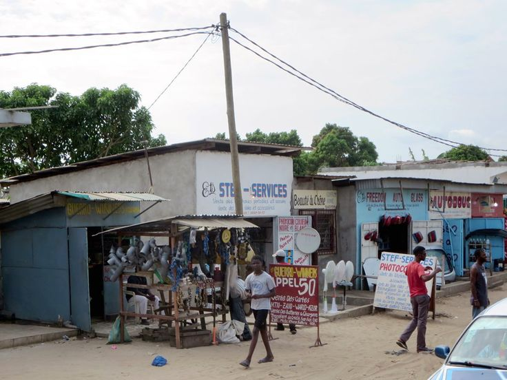 Small shops line a street in Pointe-Noire, Republic of Congo
