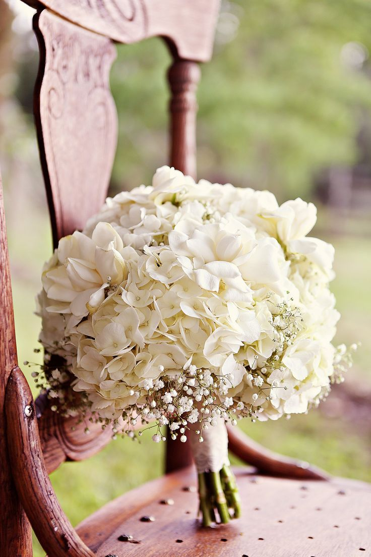 Celeste's bridal bouquet combined white hydrangeas with baby's breath for an ethereal feel.