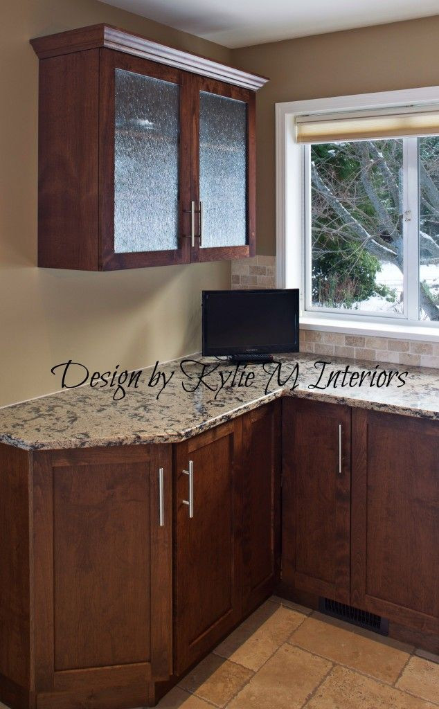 cherry kitchen cabinets with rain glass, quartz countertop, travertine tile floor and Lenox Tan BM walls