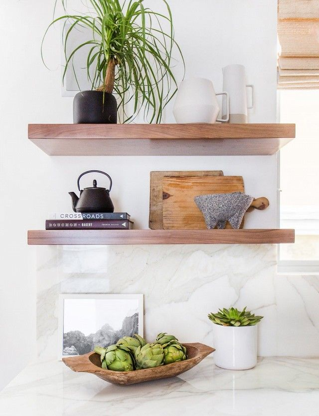 Well-styled wooden floating kitchen shelves
