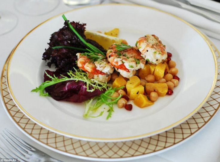 A salad of shrimp and, mango, chickpeas and leaves served on Oman Air's first and business class flights