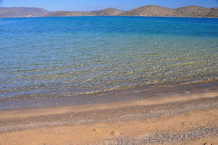 Crystal clear water of #Schisma beach in #Elounda of #Crete