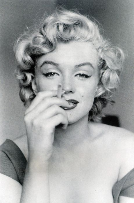 Marilyn Monroe -------- after thousands of photo's ... suddenly along comes this shot of MM and she is smoldering. A Goddess for all time... transmitting so much soul straight into that lense. What a brilliant model. Gifted.