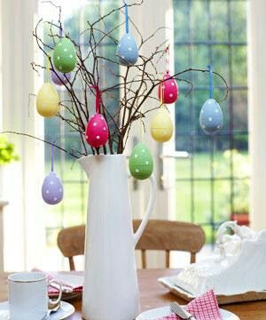 Hang Easter eggs from dried branches for a cute Easter centerpiece.