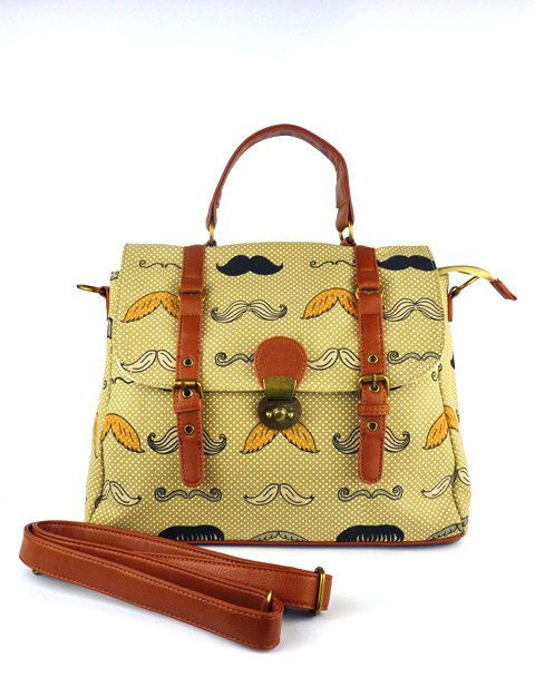 Printed bag made from cotton canvas fully lined with polka dot fabric. Handles…