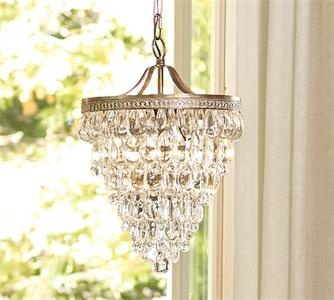 I love crystal lighting. A sparkling chandelier can really dress up a small space.