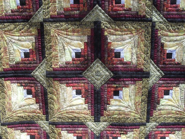 Great example of how quilting can add movement to an otherwise stationary quilt.