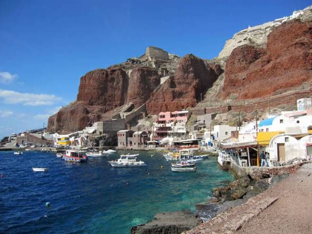 views of the caldera, descend the 300 steps from the northern city of Oia to the tiny port of Amoudi Bay