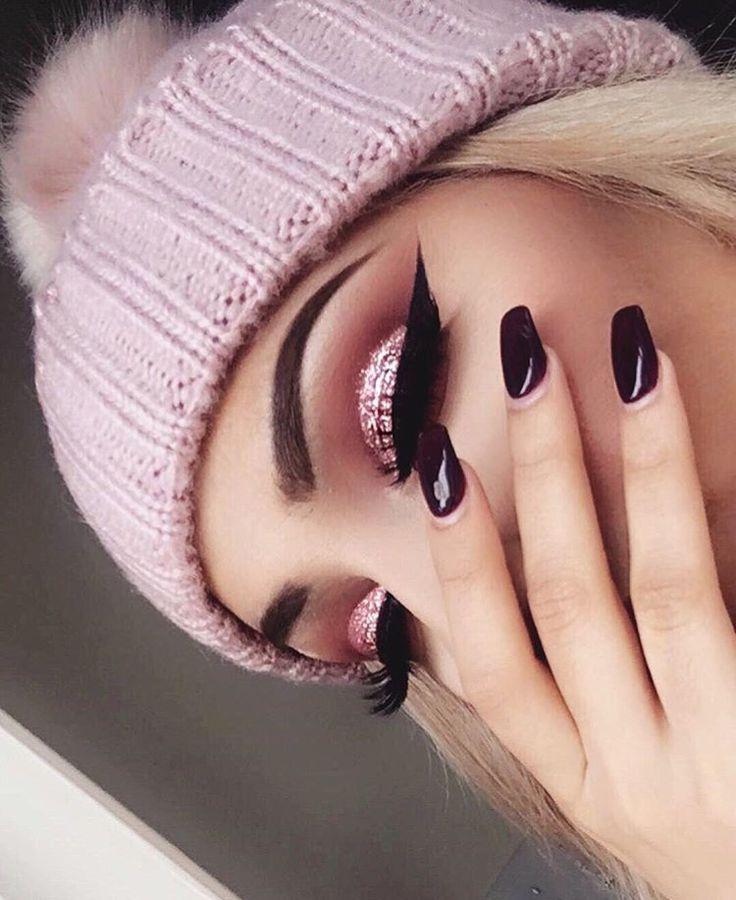 Beauty with dark purple nails,I like the eyeshadow.