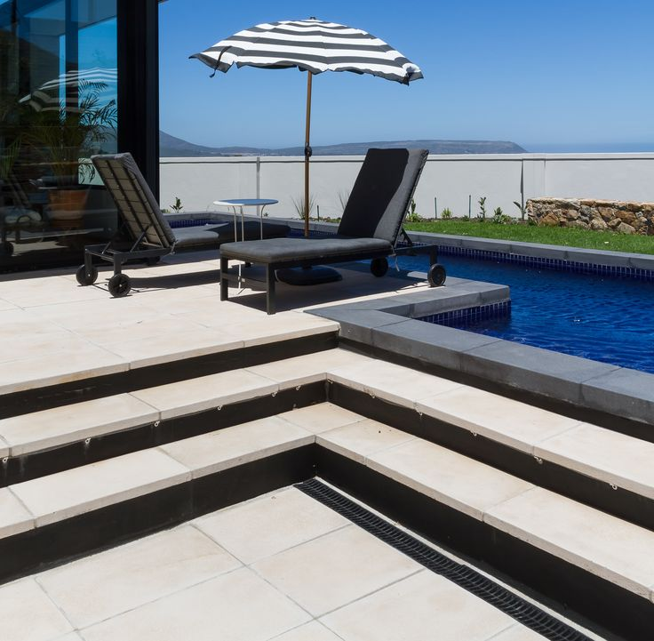 Beautiful Jura pavers around the pool and Devon Wall cappings.www.revelstone.co.za