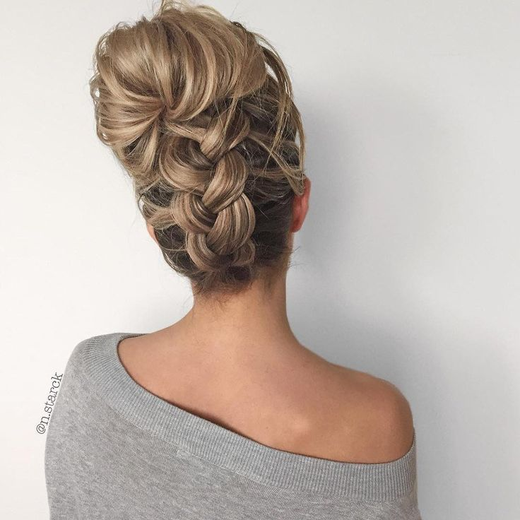 A friend will definitely come in handy — especially if you're not into passing out from hanging upside-down — but this thick, chunky braid leading up to an oversized bun is a showstopper. Bonus: It'll stand out from the sea of topknots during a heat wave.