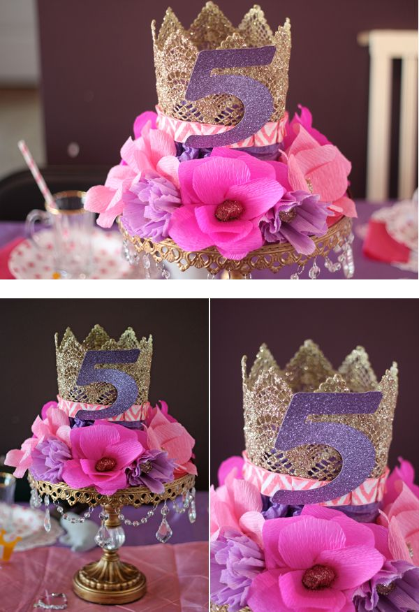 Beautiful crown and floral centerpiece on a cake stand.