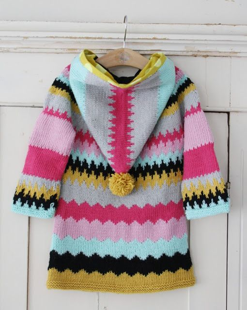 Zigzag woolen coat with a pompom