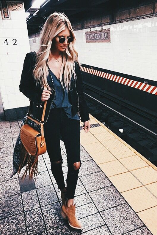 Waves, Circular Sunnies, Fringed Bag, Black Jacket, Distressed Denim And Beige Ankle Boots. Damn.