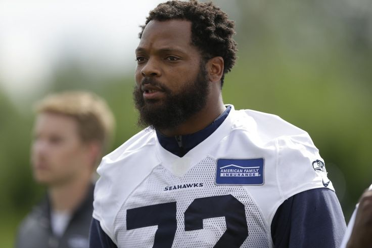 Pete Carroll supports Michael Bennett but thinks 'we should all be standing' for anthem