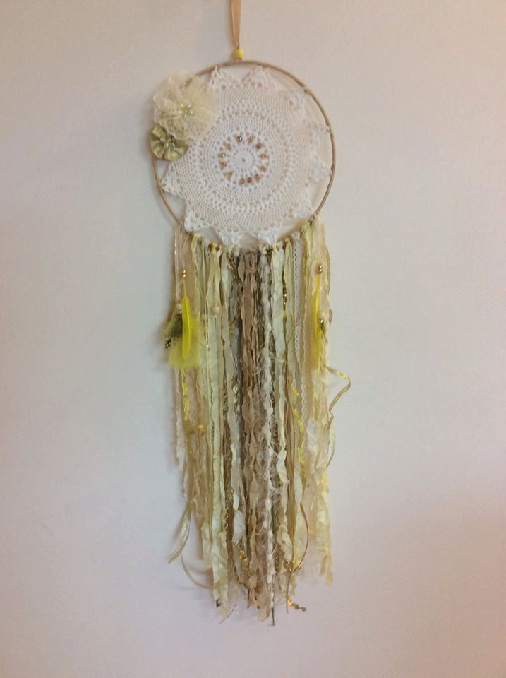 Golden doily dream catcher, with lace, ribbons and feathers.  Lots of beads and seam binding to make this a golden beauty. by DreamCatcherHeaven on Etsy
