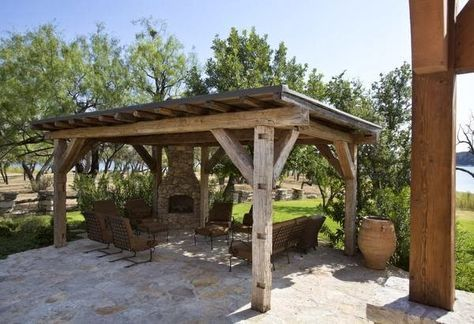 """A Rustic """"Upscale French Barn"""" Home on Possum Kingdom Lake in Texas. The owner told her architect she wanted the house to look like two old barns were put together - French barns! Outdoor Pergola .... European ambiance! Photos by Ross Hailey - If you want to see lots more photos and get more information please visit: Indulge"""