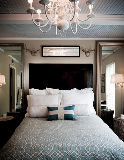 I like the full length mirrors on each side of the bed...makes the room look bigger. I also like the tall headboard!