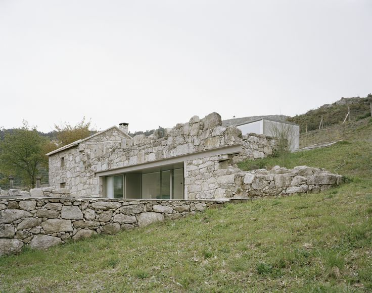 Completed in 2016 in Parada do Monte, Portugal. Images by André Cepeda . The house to be extended, a very small rural stone building, formerly inhabited by a family of 11 members, fits into the rough terrain of a large...
