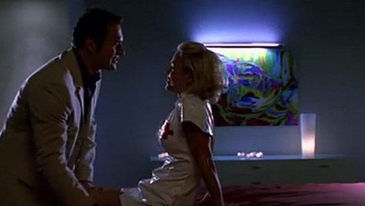 """Nip/Tuck, season 1, episode 7, """"Cliff Mantegna,"""" aired on 9 September 2003. Dr. Christian Troy is played by Julian McMahon and Kimber Henry is played by Kelly Carlson."""