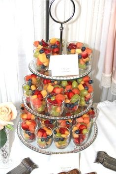Good appetizer for a party. Who doesn't love fruit salad, plus it's already in a cup so it's easy to grab. Healthier and easier than cupcakes to decorate a table.