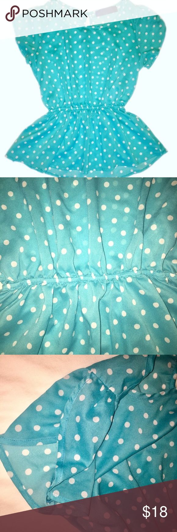 """Blue & White Polka Dot Top Adorable blouse that is a stunning shade of bright aqua with white polka dots. Cinched elastic waist. Short sleeves that overlap for a really pretty look. Button closure at neck. Semi-sheer. Bust: 17.5"""". Length: 23.5"""". Can easily be dressed up for the office or dressed down for girls night out or movie night. In excellent condition. Tops"""