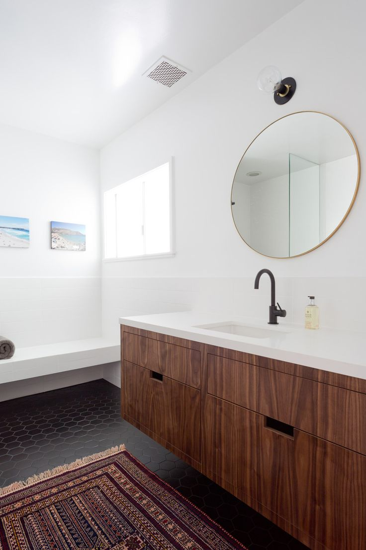 Pared Back Modern Bathroom With Round Mirror Black Floor Walnut Floating Vanity Black Faucet And Lots Of White